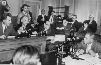 the mccarthy hearings and the hollywood the subsequent hearings focused on determining the extent of communist  us senator joseph mccarthy holds a picture showing clement.